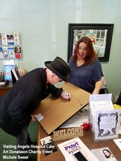 Artist Mark Lewis signing for Michele Sweet - Glendora Chamber Of Commerce